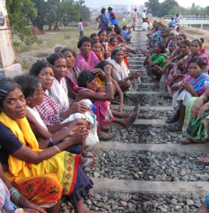 Dongria Kond women blocking railway tracks to protest the land-grab of Niyamgiri moutain in Odisha